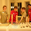 Venture Crew members were challenged to work in teams of two and were supposed to create desserts from scratch for the February 25 pasta dinner. Guests were then invited to try any or all of the entries and judge them on taste and presentation. From left is Mara Scallon, who worked with Breanne Lubinsky (not shown) to create the evening's award-winning chocolate truffles with Heath Bar topping; Rob Russo and Phil Lyon, with their cannolis; and Vik Makayee, with the trifles he had made. Guests also had chocolate truffles with crumbled cookies and a maple cake with maple icing to sample.  (Hicks photo)