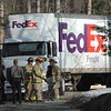 Sandy Hook firefighters and police responded to the Shady Rest section of Sandy Hook mid-afternoon on Friday, March 4, after a tractor-trailer truck that was traveling on the narrow streets of the densely developed neighborhood along Lake Zoar snagged some cables suspended from utility poles. Police said that trucker John Hurley, 63, of Shelton was driving the vehicle northward on Shepaug Road and was negotiating a curve to the left, when some low-hanging wires strung across the road got snagged on the truck. The lines that fell carry telephone and cable television signals. Hurley was not injured. Police took no enforcement.  (Gorosko photo)