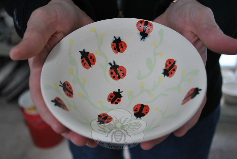 Underglazing allows detailed designs like these vines and ladybugs to decorate pottery items. This bowl will be dipped in a finished glaze, and fired at more than 2,000 degrees, before it appears at the April 2 Spring Fling.  (Crevier photo)