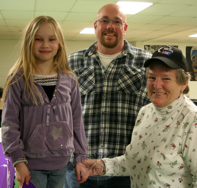 Sam Smith, center, and Betty Presnell, right, were introduced as the honorary co-chairs of Newtown Relay For Life 2011 during a kickoff meeting on March 3 that formally launched preparations for the annual event returning in June. On the left is Mrs Presnell's granddaughter, Kylie Groody.  (Hicks photo)
