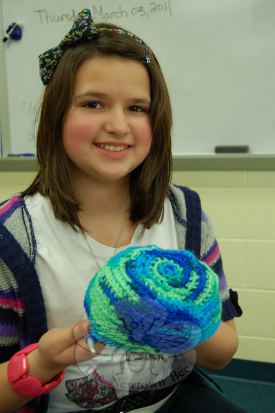 Reed Intermediate School Knitting Club member Kelly Garcia worked on one of her knitting projects during the club's March 3 meeting.  (Ashbolt photo)