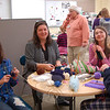 From left, Reed Knitting Club members Isobel Russo, club parent Sheila Sabin, Julianna Sabin, and Kristina Assner sit together during the club's meeting on Thursday, March 3. (Ashbolt photo)
