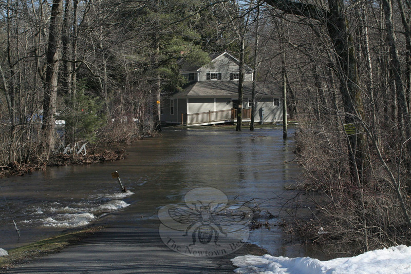 The driveway and much of the land immediately adjacent to it at 100 Wasserman Way, which leads to the headquarters for Pootatuck Fish & Game Club, was under water for much of Monday, March 7, following a strong overnight rain storm.  (Hicks photo)