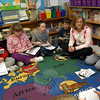 """Middle Gate fourth grade teacher Linda Baron sat with her students on Friday, February 25, to discuss the newest Dinner Plate Word, """"nonchalant.""""  (Hallabeck photo)"""