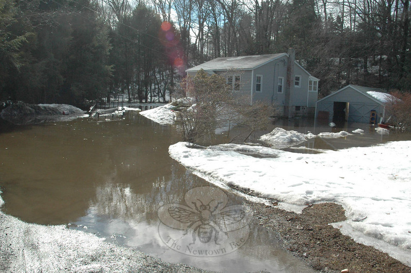 Gary Capozziello's front yard was flooded with water, while still hanging on to some snow, Monday morning. A resident of the Shady Rest section of Sandy Hook, Mr Capozziello was among many residents who had flooding problems following an intense rainstorm Sunday night.  (Voket photo)