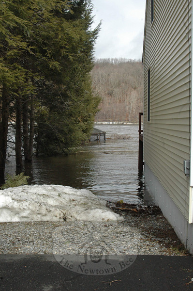 Homeowners of this house along Housatonic Trail in Sandy Hook watched as floodwaters first overtook their gazebo, then crept along the side of their home and near their deck on Monday.  (Voket photo)