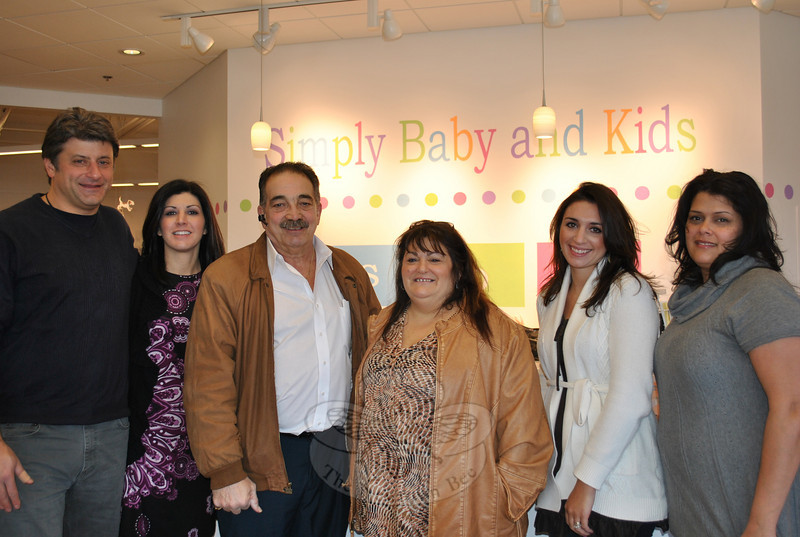 From left, Simply Baby and Kids owners Rich and Carie Turk, Make A Home founders Dan Telesco and Anita Pettengill, and Simply Baby store managers Kara Telep and Julissa Alvarado get together, after the children's furnishings store in Sand Hill Plaza handed over ownership of an unused van to the local charitable organization.  (Crevier photo)