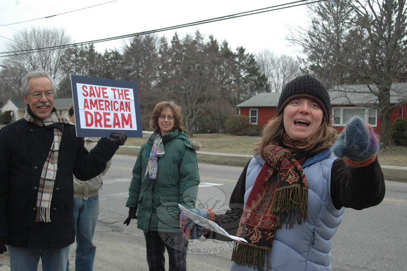Newtowner Libby Mitchell reacts to a fellow protestor Tuesday during a quickly-organized pro-labor rally that was held in front of Newtown Middle School on Queen Street.  (Voket photo)