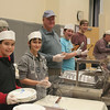 Working hard at the serving table for the first Friday Knight Fish Fry on March 11 were, from left, Andrew Ross, Jacob Harper, Gus Brennan, Nick Wolf, Mike Brennan, and Tom Chiaramonte.Friday Fish Fry events will continue this season on March 25 and April 1, each running from 5 to 8 pm at 46 Church Hill Road.  (Hicks photo)