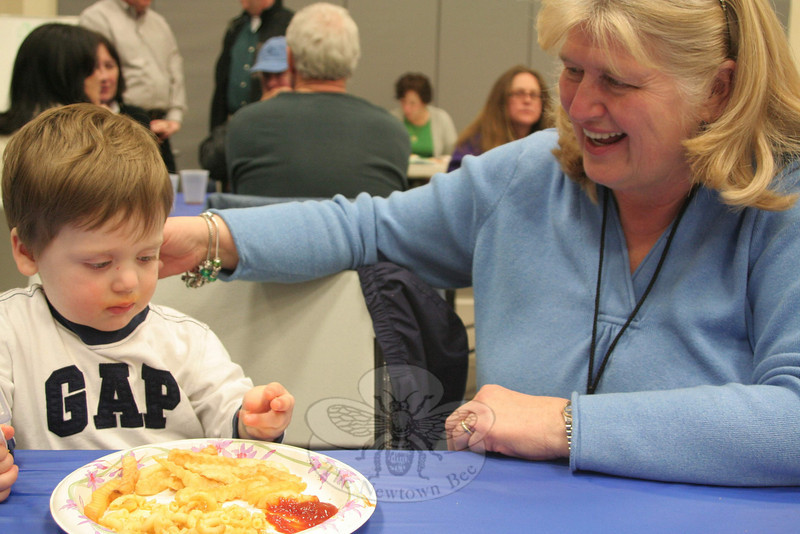 Justin Brennan, shown here with his grandmother, Anne Brennan, was one of the diners during the March 11 Friday Knight Fish Fry who opted for macaroni and cheese instead of fish and chips (although he did enjoy french fries with his pasta).  (Hicks photo)
