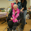 Balloons, food, flowers, and music surrounded Masonicare of Newtown resident Lillian Hansen on Sunday, March 6, as she celebrated her 100th birthday. Granddaughters Gail Hreschak, left, and Sue Doceti stood with Ms Hansen for the photo. Other family members were in attendance for the event, but are not pictured.  (Hallabeck photo)