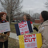 From left, Sandy Charles, Christine Flint, and Judith McLellan, all of Southbury, engaged in an animated discussion as a pro-labor rally sponsored by MoveOn.org drew to a close Tuesday evening on Queen Street.  (Voket photo)