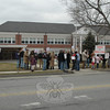 About 30 attendees gathered for a brief rally Tuesday afternoon in front of Newtown Middle School. The activity was part of a nationwide initiative by the pro-labor organization MoveOn.org, and organized by Newtown resident Dr Curt Riebeling to provide support for Wisconsin state workers whose rights to collective bargaining are threatened by new legislation proposed by the state's new Republican governor.  (Voket photo)