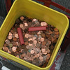 The scale above shows 85 pounds, but John Sansburg deducted two pounds to account for the weight of the bucket in his calculations of about 14,800 coins, or about $148, for Patrick Briscoe's 9/11 Forget Me Not Pennies Collection.  (Hicks photo)