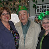 "Newtown Senior Center Director Marilyn Place greets Senior Center members Joe and Louise Previte of Bethel as they arrive for ""Music From the Heart."" Like many other members Tuesday afternoon, the Prevites were dressed to celebrate St Patrick's Day. ""It's St Patrick's Day, every day this week, at the center,"" laughed Ms Place.  (Crevier photo)"