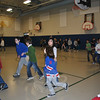 Fourth grade students from the classes of Michael Wight and Stephanie Dunshee jog around the gymnasium of Hawley School, Friday, March 11, prior to settling into Connecticut Mastery Tests. Fourth grade classes are split between ten-minute jogging and yoga sessions each morning during the two weeks of testing, in hopes of improving focus and concentration, as hypothesized by recent research.  (Crevier photo)