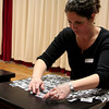 Kim Pollard was among those adding photos to the Laughing Tables and Laughing Chairs during a March 11 work session at Head O' Meadow School.  (Hicks photo)