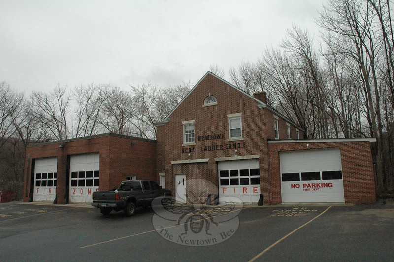 The aging deteriorated Newtown Hook & Ladder firehouse is located at 45 Main Street, behind Edmond Town Hall. Hook & Ladder has proposed building a new firehouse at 12 Sugar Street (Route 302), but that project has encountered stumbling blocks. Town and fire officials are considering the prospect of using the town-owned property its same 45 Main Street address as the site for a new firehouse if the project does not materialize at 12 Sugar Street.  (Gorosko photo)