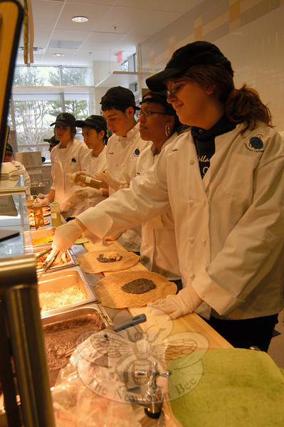 Newtown High School culinary students serve up burritos to staff, faculty, and students at the school on Thursday, March 31. The flour tortilla wrapped food is a recent addition to the NHS culinary arts program.  (Hallabeck photo)