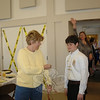 "Connor Hanley, a Newtown High School freshman, had just pinned a ""hug"" on his grandmother Heidi Mang at the 2011 Workcamp fundraiser and breakfast. Connor's hugs were fashioned out of clothespins that he could clip to various attendees so they could stick with the recipients while he travels to West Virginia on the summer Newtown Ecumenical Workcamp Students (NEWS) journey to help Appalachian families on a human services mission this summer."