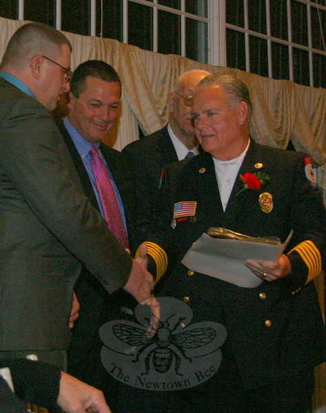 Bill Halstead received a plaque, pin and certificate from the Connecticut State Firefighters Association on April 6, marking his inception into the CSFA Hall of Fame. His name has been added, along with the names of 11 other new inductees, to a permanent plaque at the Connecticut State Fire Academy.  (Hicks photo)