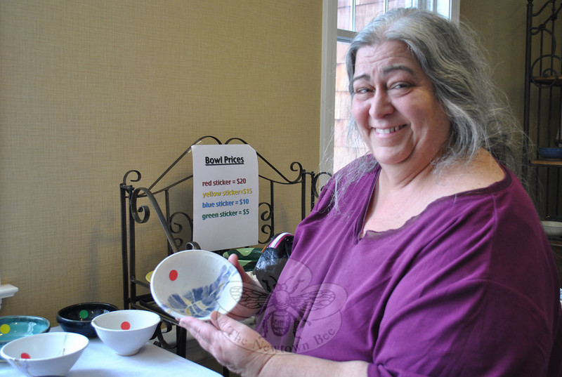 Phyllis Zimmer of Sandy Hook was pleased by the selection of handmade ceramic bowls she found during Spring Fest, a special event at Maplewood at Newtown on Saturday, April 2. (Crevier photo)