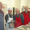 Members of Newtown Congregational Church's Men's Group and Newtown Lions Club members worked together in the kitchen, preparing the meal for the 2011 NEWS Fundraising Breakfast on April 2.  (Voket photo)