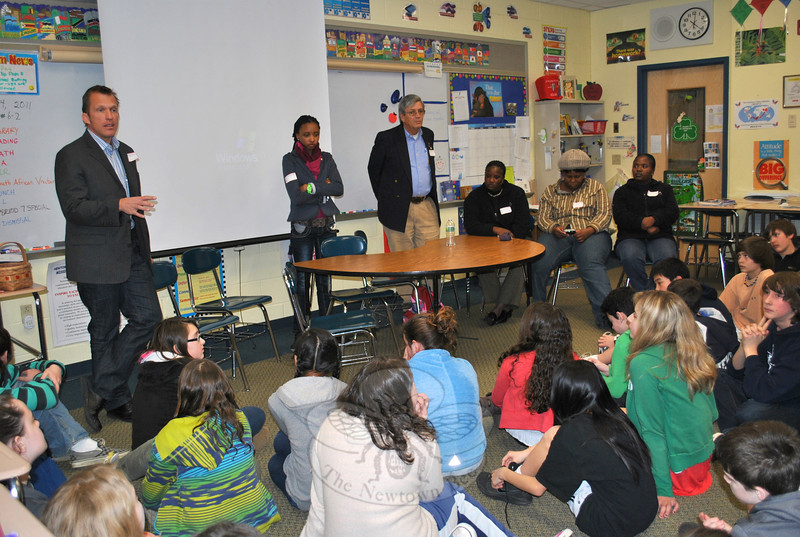 Clinical psychologist Sean Tunmer, far left, answers questions about South Africa from sixth graders at Reed Intermediate School on Monday, April 4. Looking on are Elaine Serekwane, Peter van den Elshout, Maria Semenya, Obikeng Khunou, and Bertha Mahube, all educators in Rustenburg, South Africa. The group is visiting the area as part of a Rotary International partnership between Bridgeport Early Childhood Education and rural South African schools.  (Crevier photo)