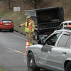 A Hawleyville firefighter directs traffic during the evening rush on April 12 at the Exit 9 on-ramp for westbound Interstate 84, following a one-vehicle accident there that caused travel delays in the area. State police said that Peter K. Rolf, 64, of Bethel was driving a 2007 Dodge Ram 3500 truck, shown behind the firefighter, on the ramp at about 4:53 pm, when Rolf lost control of the truck and struck several road signs. Rolf failed field sobriety tests and was charged with driving under the influence, state police said. Rolf was not injured in the incident, but was transported by Newtown ambulance volunteers to Danbury Hospital for a medical evaluation due to his intoxication. State police said Rolf was released from custody on $500 bail for a May 2 appearance in Danbury Superior Court.  (Gorosko photo)