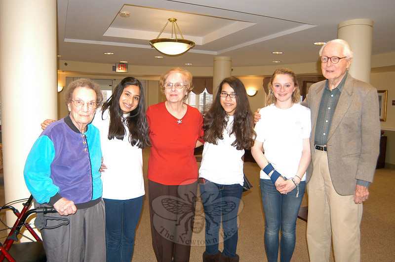 "Lockwood Lodge residents stood with the Newtown Middle School volunteer group ""Senior Smiles"" on Friday, April 1. From left are Fran Ballard, Maria Labati, Florence Montreys, Alondra Marmolejos, Alyson Montague, and Richard Ayers.  (Hallabeck photo)"
