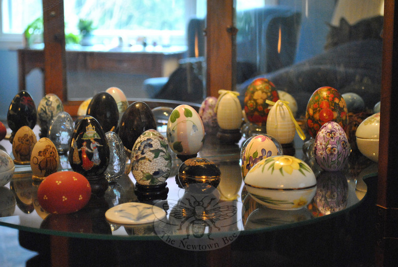 From the elegant Limoges-style egg (front center) to the whimsical handpainted teddy bear egg (left rear), each egg in Sara Washicko's collection holds a special place in her heart.  (Crevier photo)