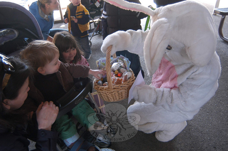 A costumed Newtown Parks & Recreation Director of Recreation RoseAnn Reggiao welcomed dozens of children for the annual Spring Egg Hunt at Dickinson Park on April 16.  (Hallabeck photo)
