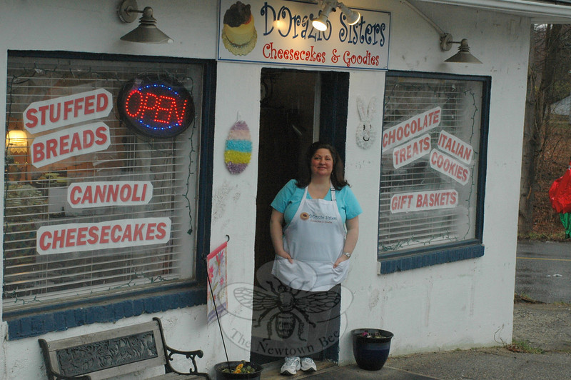 JoJo D'Orazio welcomes visitors to DOrazio Sisters Cheesecakes & Goodies on the Newtown-Monroe town line, while her sister and co-owner, AnnMarie, takes care of most of the hands-on baking chores at a commercial kitchen the sisters lease at The Waterview in Monroe.  (Voket photo)