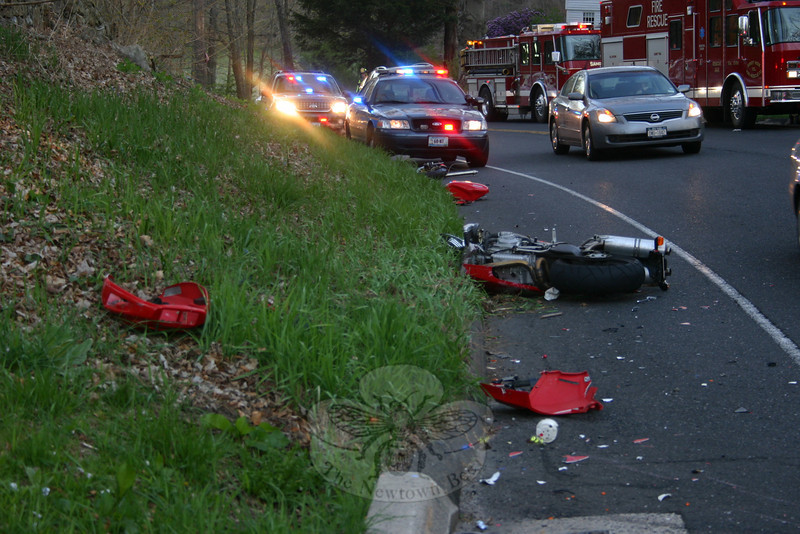 According to the Yale School of Medicine, motorcycle crashes involving riders without helmets like this crash in Sandy Hook in 2010 contribute to increased fatalities and injuries that likely cost billions of dollars in hospital and rehabilitation bills. The goal of the study was to assess the association of helmet use with motorcycle crash mortality and to identify characteristics of those riders who were involved in Connecticut crashes.  (Bee file photo/Hicks)
