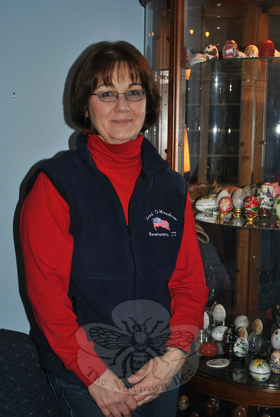 Sara Washicko stands next to the curio cabinet that houses her collection of nearly 90 novelty and decorative art eggs. The collection started when she was a child, and her maternal grandmother and great aunt began giving Ms Washicko and her siblings a special egg each Easter.  (Crevier photo)