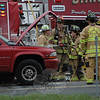 Sandy Hook firefighters extinguished a smoky fire in the engine compartment of a Dodge Durango SUV near the end of the Exit 11 off-ramp of Interstate 84 about 7:45 am on April 14. The vehicle fire and a separate minor two-vehicle accident that had occurred nearby at about the same time caused travel delays in the area during the morning rush period.  (Gorosko photo)
