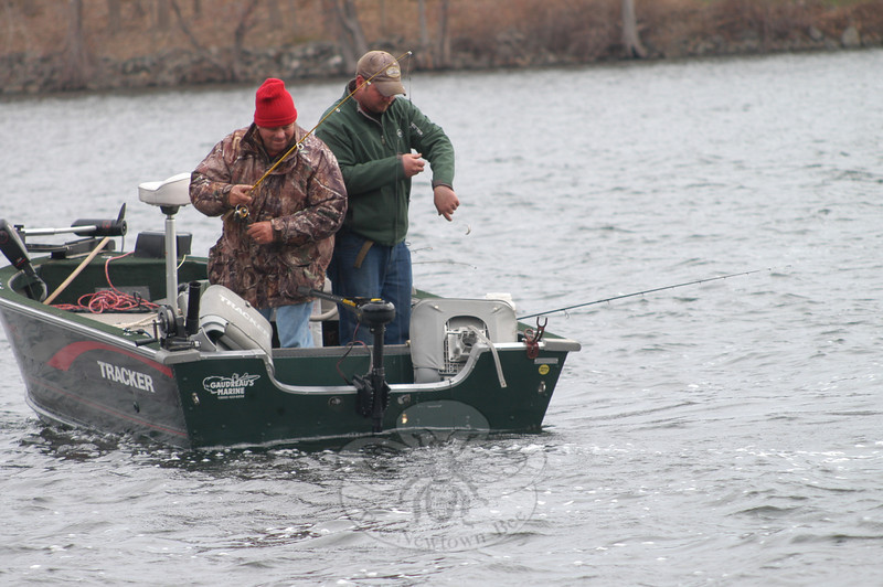 Don Butler Sr, left, and Don Butler Jr, of Newtown, bring their boat in on opening day of fishing season.  (Hutchison photo)