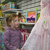 At Good Ideas, A Parent Teacher Store on April 16, 3-year-old Tessa Marie Hynes admires a Cinderella-like dress. Good Ideas provided a day's worth of family activities on Saturday, including a visit from the Easter Bunny, crafts, and face painting, to celebrate the official grand opening of the Newtown store. Good Ideas is a resource for teaching supplies and specialty toys.  (Crevier photo)