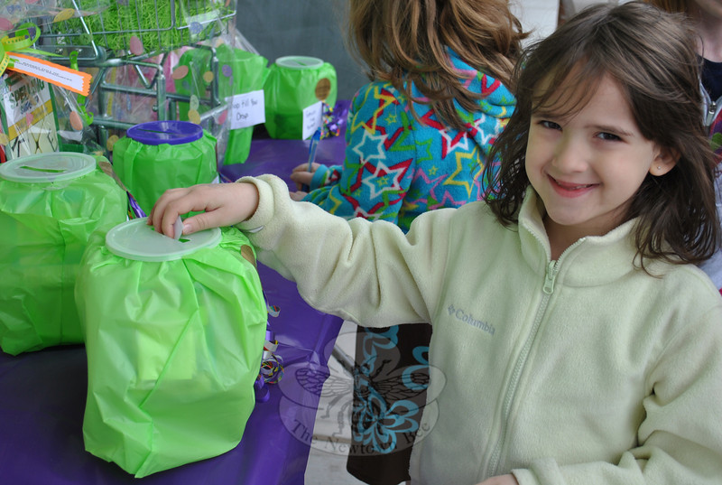 Alexis Wasik, age 6, takes a chance on one of ten gift baskets raffled off at Good Ideas, A Parent Teacher Store, in Plaza South, Saturday morning, April 16.  (Crevier photo)