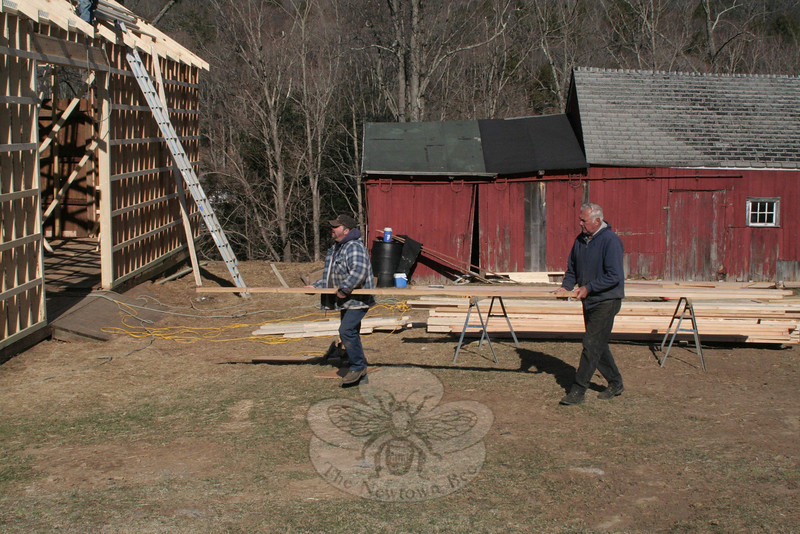 John Ferris and Bob Staudinger worked with the crew from Pennsylvania on all stages of the Staudinger barn's reconstruction.  (Hicks photo)