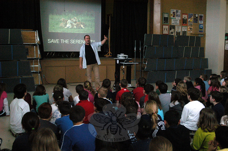 Sandy Hook School students learned about the Serengeti and a possible highway project in Tanzania that could upset the migration pattern of wildebeests when presenter Guy Combs spoke at the school on Thursday, March 31.  (Hallabeck photo)