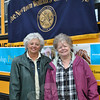 "JoAnn Bruno, left, and Yvonne Kopins of the Newtown Woman's Club, GFWC, Inc, stand in front of Bus 13, owned by Phil Carroll, Saturday morning, April 16, collecting food for the club's fifth annual ""Stuff A Bus"" food drive to support the Newtown Social Services Salvation Army Food Cupboard at 3 Main Street, and FAITH Food Pantry, located at St John's Episcopal Church in Sandy Hook. The bus, donated for the day by Mr Carroll, was parked in the lot of the Stop & Shop at Sand Hill Plaza, and despite the chilly and rainy day, shoppers donated generously to the cause.  (Crevier photo)"