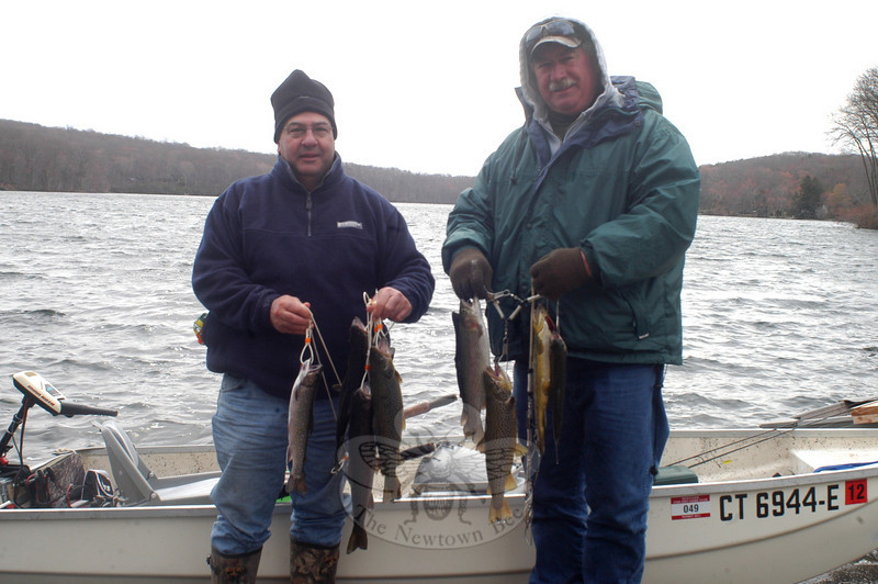 Gary Cascio of Monroe, left, and Mike Vidmosko, of Stratford, had some good luck on opening day of fishing season, April 23.  (Hutchison photo)