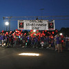 Newtown hosted its first full Light The Night event, a fundraiser for The Leukemia & Lymphoma Society, on Saturday, September 25. The event took place on the grounds in front of Newtown Youth Academy and included live music, refreshments, LLS and related information, and a two-lap walk with participants carrying balloons to identify themselves as cancer survivors, supporters of LLS and its programs, and in honor of those who have died from the two blood related diseases. Jenna Dos Santos, the 4-year-old one in the white T-shirt near the center of this group stepping off on the walk, was this year's Light the Night Honored Hero.  (Hicks photo)