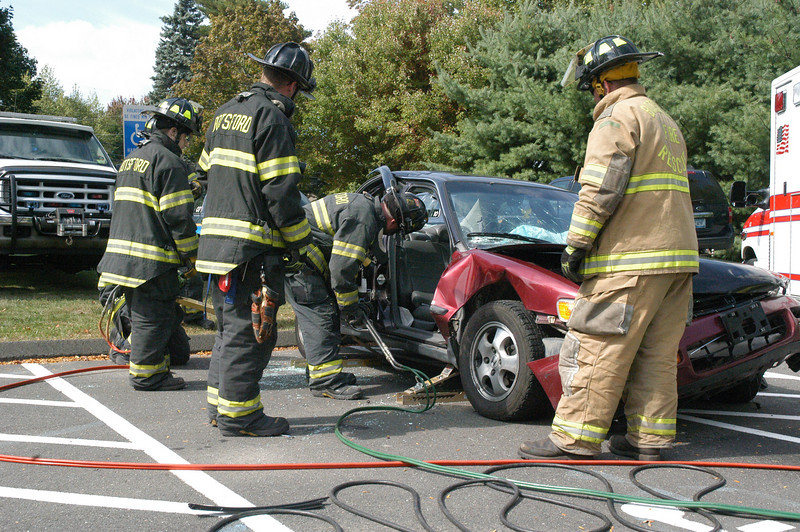 In a simulation, Botsford Fire Rescue members demonstrated the steps they take to disassemble a motor vehicle when they need to free a person who is trapped inside the vehicle after a serious accident.  (Gorosko photo)