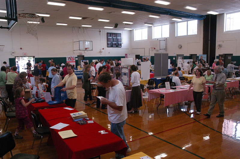 The Newtown Middle School gymnasium had scores of exhibitors at Newtown's 17th Annual Great American Health & Public Safety Fair.  (Gorosko photo)