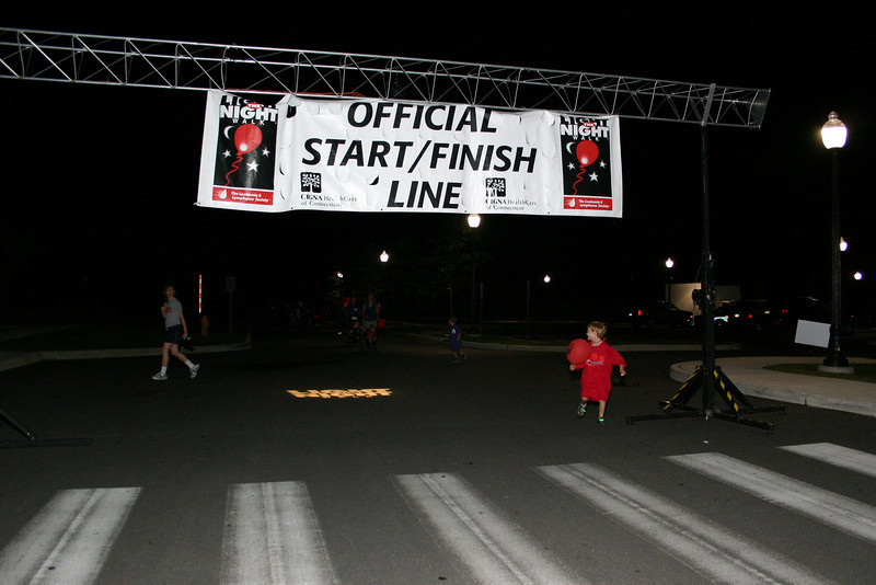 Robert Malgioglio of Monroe made a running finish when he finished his two Light The Night laps.  (Hicks photo)
