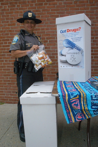 Police Officer Maryhelen McCarthy holds a bagful of unneeded prescription medications that were brought to the health fair by residents for proper disposal by the US Drug Enforcement Agency. (Gorosko photo)