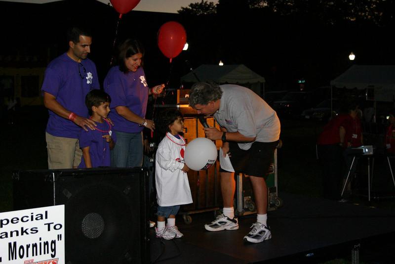 "Newtown hosted its first full Light The Night event, a fundraiser for The Leukemia & Lymphoma Society, on Saturday, September 25. The event took place on the grounds in front of Newtown Youth Academy and included live music, refreshments, LLS and related information, and a two-lap walk with participants carrying balloons to identify themselves as cancer survivors, supporters of LLS and its programs, and in honor of those who have died from the two blood related diseases. Jenna Dos Santos, in the white T-shirt, was at the event with her brother and parents and carried the special title of this year's Light the Night Honored Hero. Bill Trotta, ""Mr Morning"" for radio station KICKS FM, interviewed Jenna before the event's two laps.  (Hicks photo)"