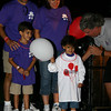 "Newtown hosted its first full Light The Night event, a fundraiser for The Leukemia & Lymphoma Society, on Saturday, September 25. Jenna Dos Santos, in the white T-shirt, was at the event with her brother and parents and carried the special title of this year's Light the Night Honored Hero. Bill Trotta, ""Mr Morning"" for radio station KICKS FM, interviewed Jenna before the event's two laps. Jenna, age 4, was diagnosed in May 2009 with Acute Lymphoblastic Leukemia and is about halfway through her expected two and a half years of necessary chemotherapy and other treatments.  (Hicks photo)"